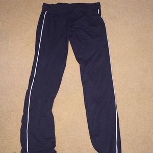 Black champion sweat pants with white stripe